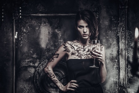 Tattooed beautiful woman in old spooky interior 免版税图像 - 37494665