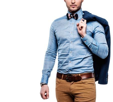 Sharp dressed fashionist with jacket over shoulder Stock Photo