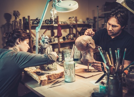 People working in a prosthetic special fx workshop Stock Photo