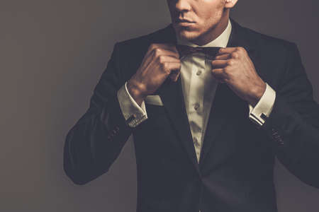 Sharp dressed man wearing jacket and bow tie Stock Photo - 39546000