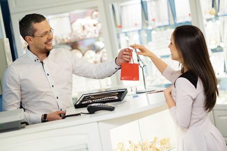 Happy woman customer in a jewellery shop