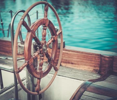 Helm on a vintage wooden yacht Stok Fotoğraf - 41535805