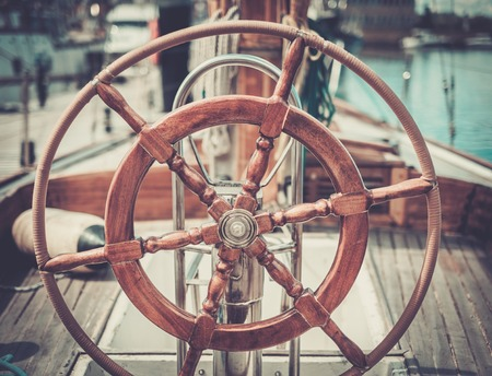 Helm on a vintage wooden yacht