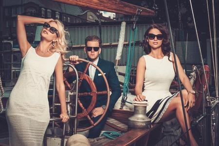 Stylish wealthy friends on a luxury yacht