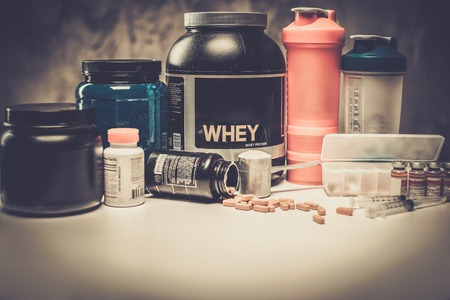 Bodybuilding nutrition supplements and chemistry 스톡 콘텐츠
