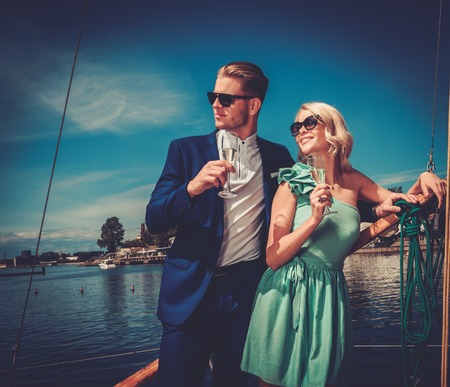 Stylish wealthy couple on a luxury yacht 免版税图像 - 42094147