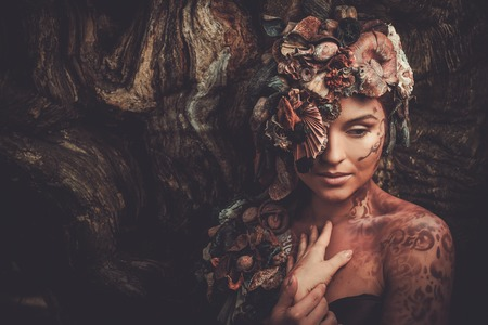 Nymph woman in a magical forest Stock Photo