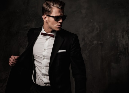 Tough sharp dressed man in black suit Stok Fotoğraf - 42094287
