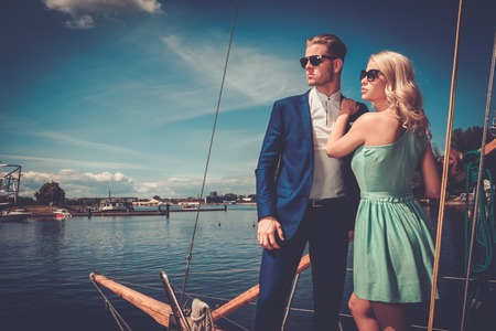 Stylish wealthy couple on a luxury yacht Imagens - 42273614