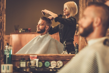 Client visiting hairstylist in barber shop Archivio Fotografico