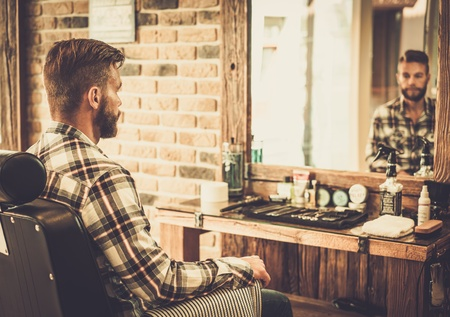 Stylish man in a barber shop Imagens - 42859726