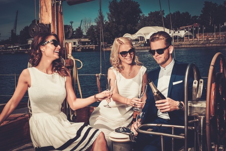 Stylish wealthy friends having fun on a luxury yacht Stock Photo - 42859748