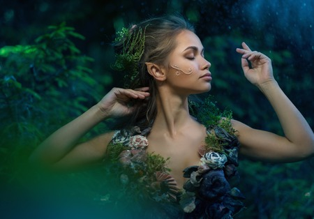 Elf woman in a magical forest Archivio Fotografico