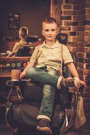 Stylish little boy in a barber shop