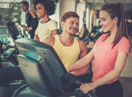 Trainer explaining how to use treadmill