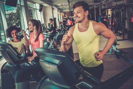 Man running on a treadmill in a gym 写真素材