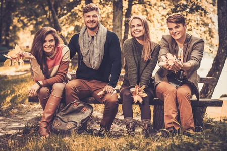 Cheerful friends in autumn park Stock Photo