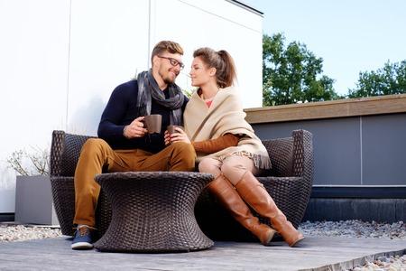 Cheerful couple on a terrace on autumn day Foto de archivo