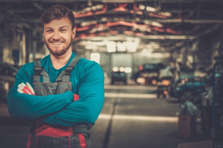 Cheerful serviceman in a car workshop Stock fotó