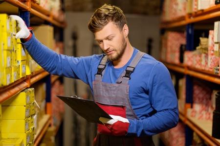 Worker on a automotive spare parts warehouse Banco de Imagens - 46292081