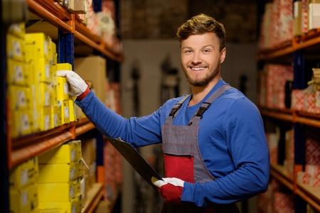 Worker on a automotive spare parts warehouse Фото со стока - 46292118