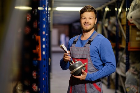 Worker on a automotive spare parts warehouse Banco de Imagens - 46292150