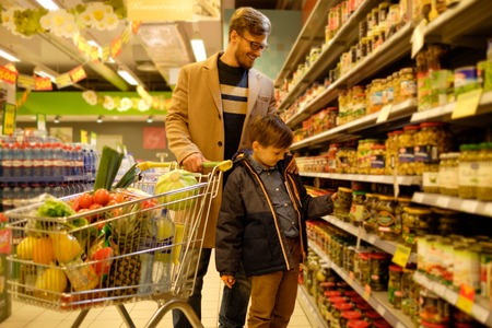 Father and son in a grocery store Stock Photo