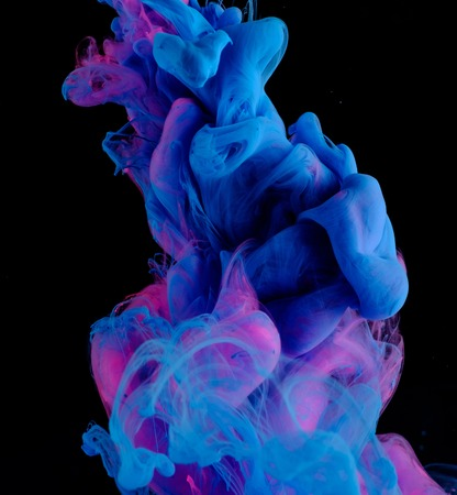 Blue pink clouds of ink in liquid isolated on black 版權商用圖片 - 49591396