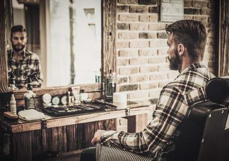 Stylish man in a barber shop Imagens - 49822485