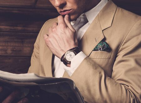 Stylish man wearing jacket in rural cottage interior