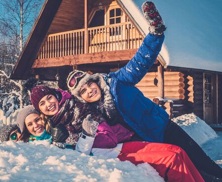 Friends spending winter holiday on mountain cottage.