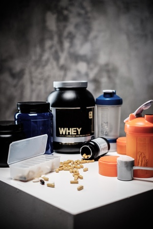 Bodybuilding nutrition supplements and chemistry Stock Photo