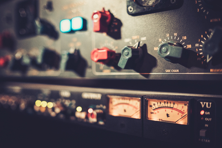 Close-up amplifier equipment with sliders and knobs at boutique recording studio. Stock Photo - 51873354