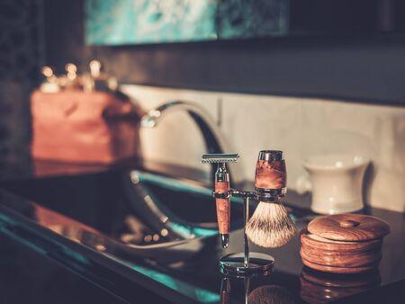 Gentleman's accessories in a luxury bathroom interior. Imagens