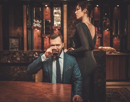 Well-dressed couple in luxury apartment interior. Foto de archivo