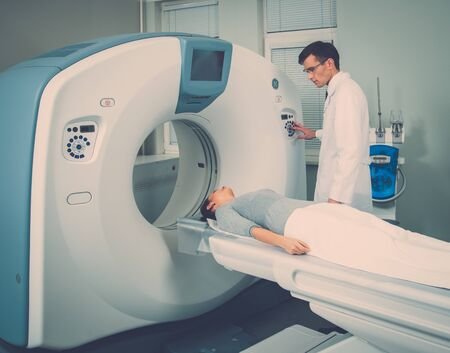 Young woman visiting computed tomography lab Stock Photo