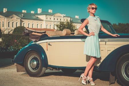 Beautiful lady near classic convertible Stockfoto