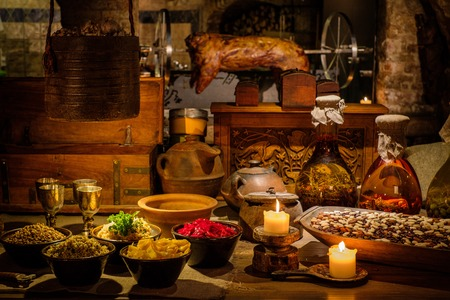 Medieval ancient kitchen table with typical food in royal castle.