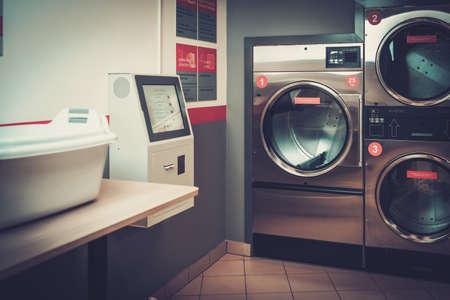 Laundry machines at laundromat shop Reklamní fotografie