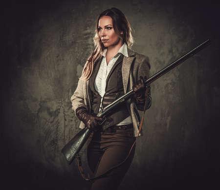 Lady with shotgun from wild west on dark background. Stock fotó - 62170908