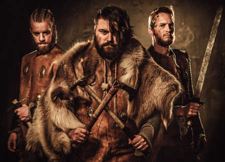 Mad vikings warriors posing in studio.