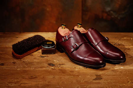 Still life with men's leather shoes and accessories for shoes care 免版税图像