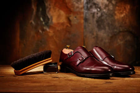 Still life with men's leather shoes and accessories for shoes care Stok Fotoğraf
