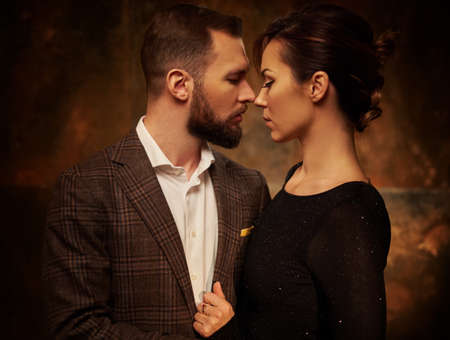 Portrait of well-dressed couple in expression of feelings.