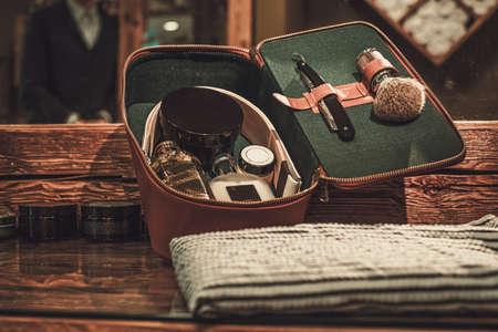 Gentlemans accessories on a luxury wooden board.
