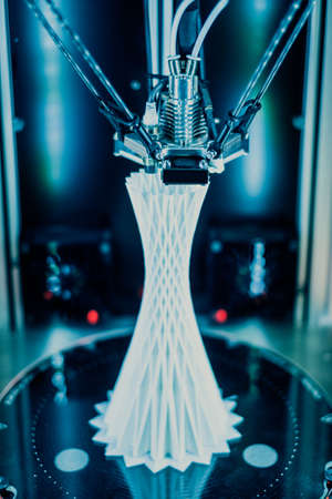 3D printer printing plastic tower. Stock Photo