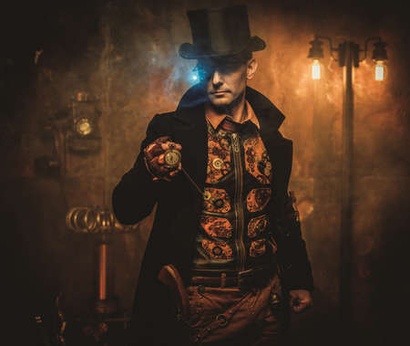 Steampunk man with pocket watch on vintage steampunk background