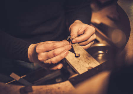 Jeweler at work in jewelery workshop