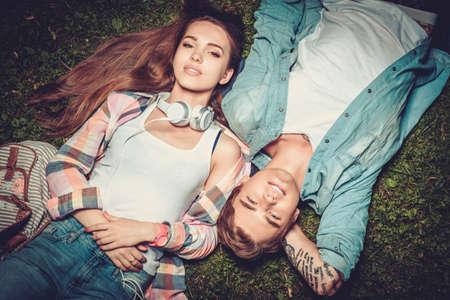 Cheerful couple resting in green park Foto de archivo