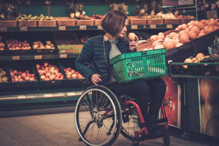 Disabled woman in a wheelchair in a grocery store